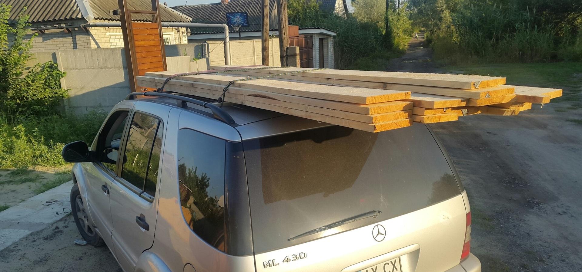 Крепление досок на крыше машины