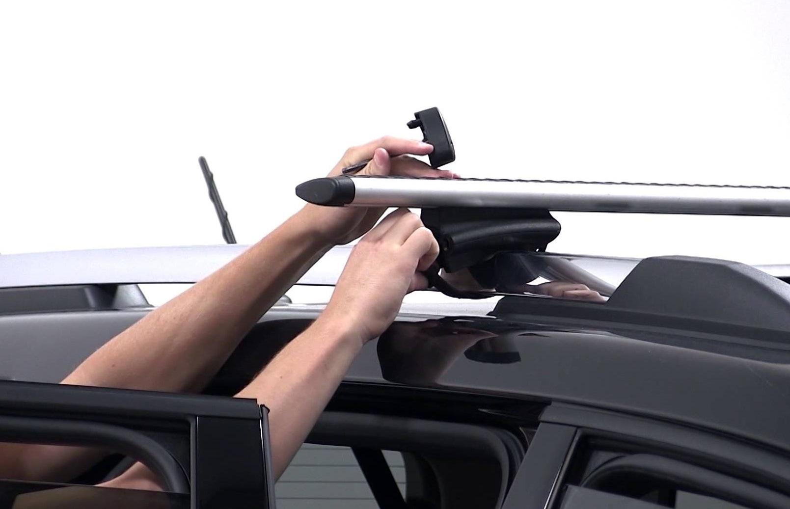 Снятие багажника с крыши автомобиля