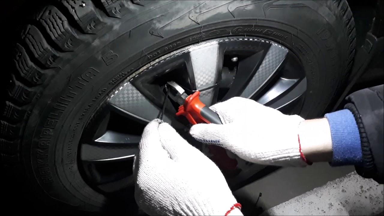 Способ крепления колпаков на колеса